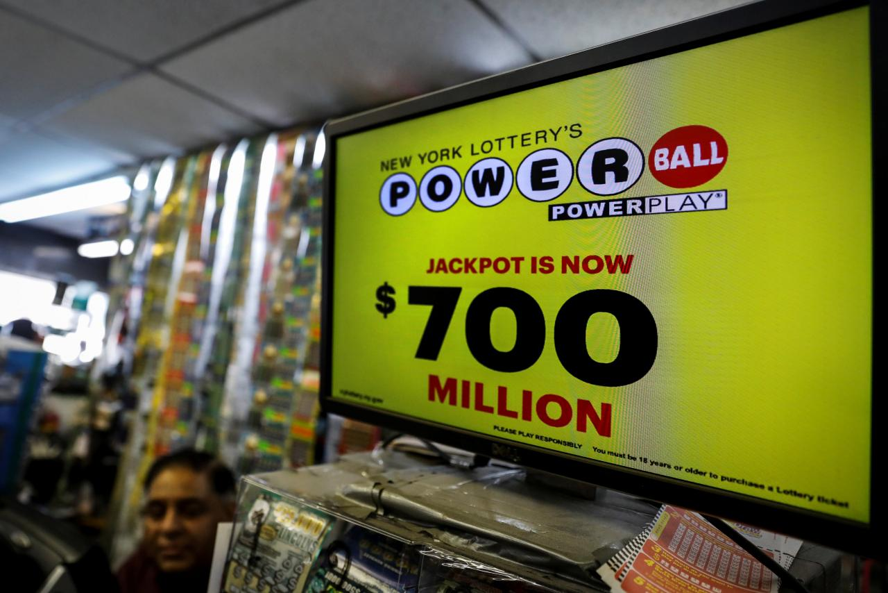 A screen displays the value of the Powerball jackpot at a store in New York City, U.S., August 22, 2017.